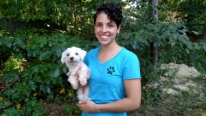 Adriana with her adopted Maltese, Rosie.
