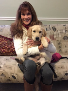 Ann with her adorable 16-week old client, Riley.