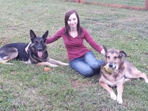 Leighton with her two German Shepherds, Copper and Kenai.